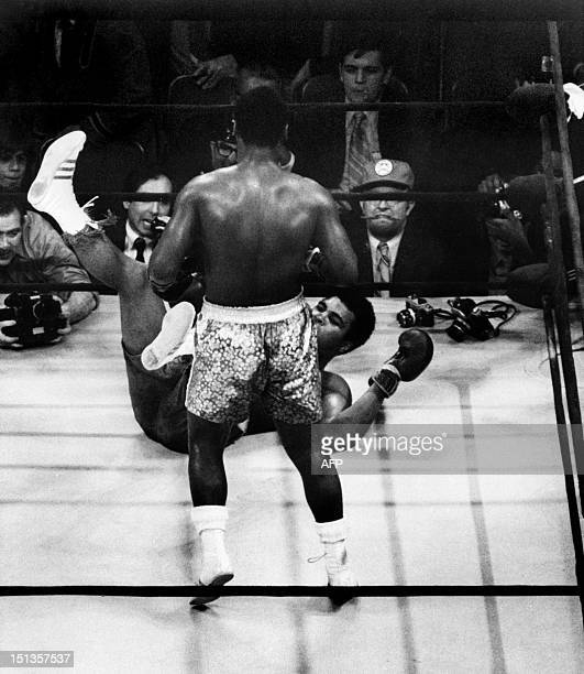American heavyweight boxing champion Joe Frazier kept his title at the end of the fight called the 'match of the century' against his compatriot...