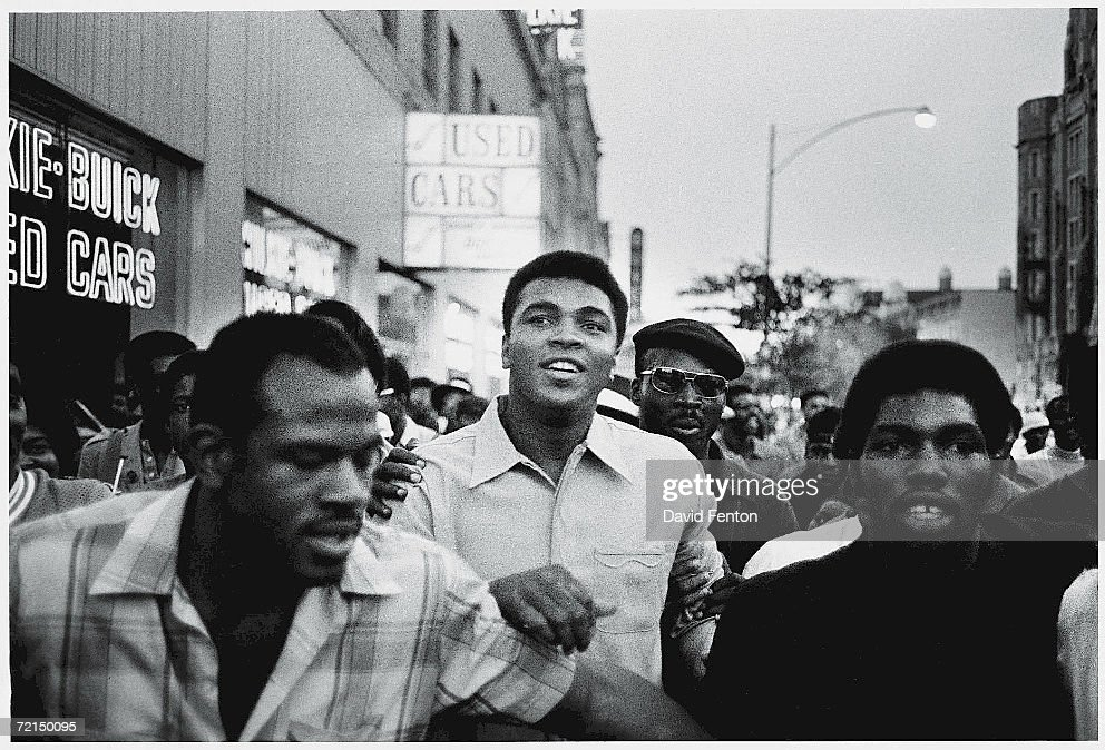 American heavyweight boxing champion Muhammad Ali walks through the streets with members of the Black Panther Party, New York, New York, September 1970. Ali was sentenced to five years in prison and his championship title revoked after he was convicted of draft evasion upon his refusal to serve with the American army in Vietnam upon grounds of conscientious objection. The decision was overtuned in 1971 but Ali became a figurehead of resistance and a hero of the people.