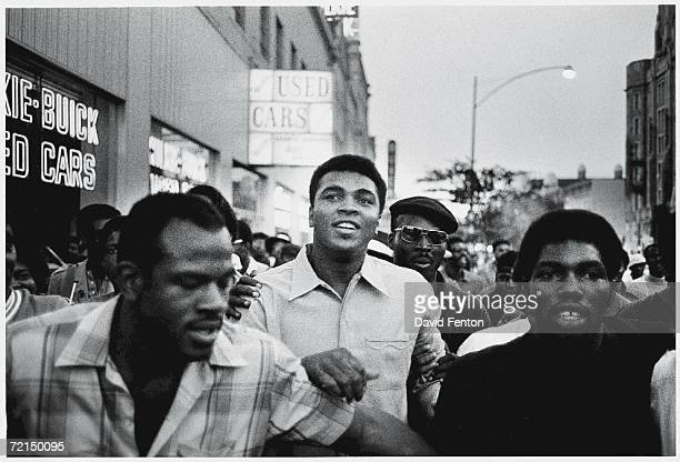 American heavyweight boxing champion Muhammad Ali walks through the streets with members of the Black Panther Party New York New York September 1970...