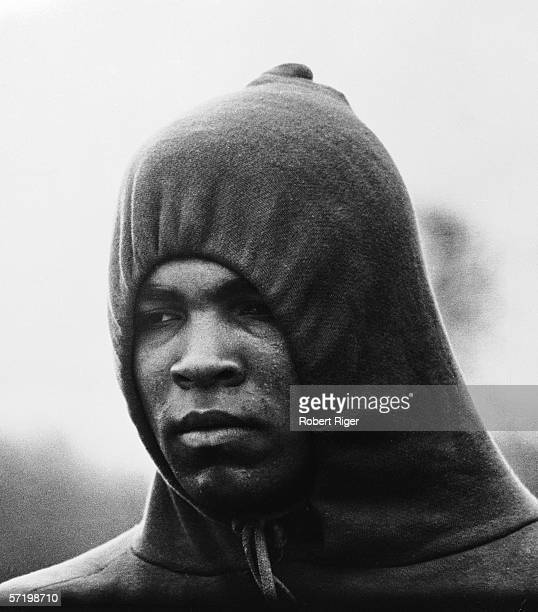 American heavyweight boxing champion Muhammad Ali wears a hooded sweatshirt as he trains in the early morning for his title defense rematch against...