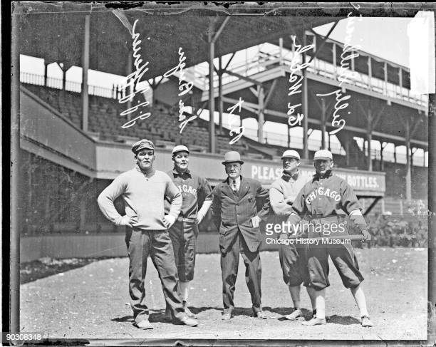 American heavyweight boxing champions James J Jeffries and Samuel Berger stand with baseball players Ed Walsh and Billy Sullivan both of the Chicago...