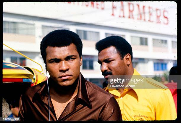 American Heavywight boxer Muhammad Ali and his brother Rahman walk together on a street Manila Philippines mid 1975 They were in the country for...