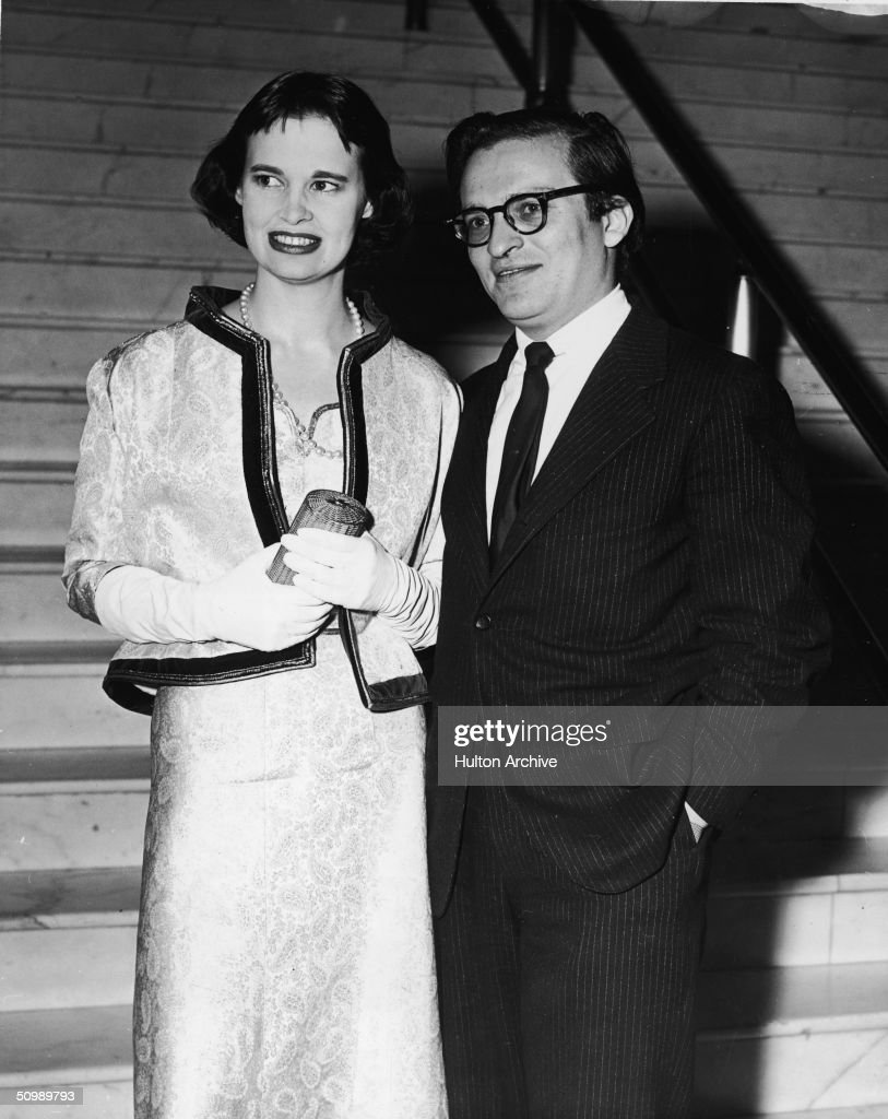 American heiress and designer Gloria Vanderbilt and her second husband American film director Sidney Lumet stand together at the foot of a marble...
