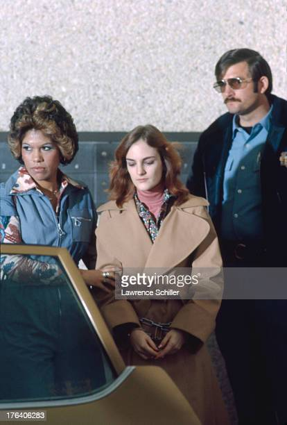 American heiress Patty Hearst is escorted by Federal Marshall Janey Jiminez and an unidentified police officer from her holding cell during her trial...