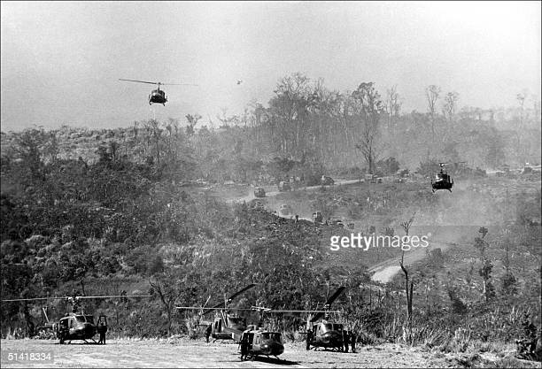 American helicopters land at Khe Sanh base on the Laos border 01 February 1971 after it was 'reactivated' following a Vitcong offensive in Laos