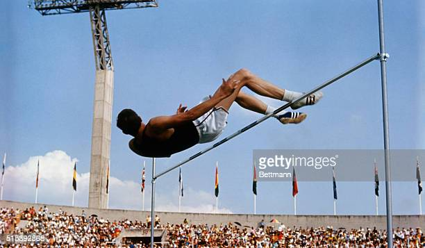 American high jumper Dick Fosbury clears the bar on his third attempt at the 1968 Summer Games in Mexico City Fosbury won the gold medal with this...