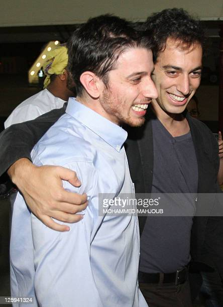 American hiker Josh Fattal is hugged by hs brother after stepping off an Omani Royal Air Force plane on September 21 2011 in Muscat Oman after Tehran...