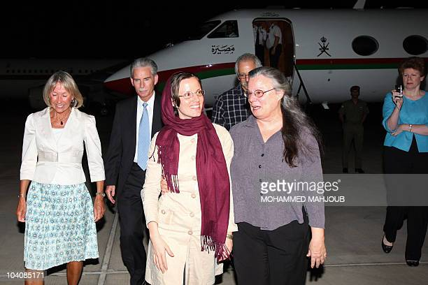 American hiker Sarah Shourd who was released by Iran after more than 13 months in detention walks with mother Nora upon her arrival at the Omani...