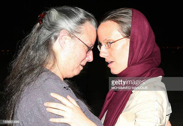 American hiker Sarah Shourd who was released by Iran after more than 13 months in detention embraces her mother Nora upon her arrival at the Omani...