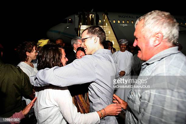 American hiker Shane Bauer and Josh Fattal are greeted on September 21 2011 in Muscat Oman after Tehran released them on bail months after handing...