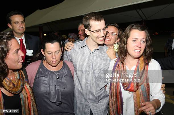 American hiker Shane Bauer poses with his mother and two sisters and fiancee Sarah Shourd after stepping off an Omani Royal Air Force plane on...