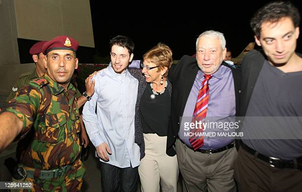 American hikers Josh Fattal and Shane Bauer are greeted on September 21 2011 in Muscat Oman after Tehran released them on bail months after handing...