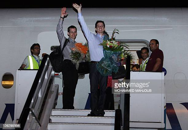 American hikers Josh Fattal and Shane Bauer wave as they board a plane back to the USA at Muscat International airport on September 24 2011 Bauer and...