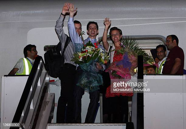 American hikers Josh Fattal Shane Bauer and his fiancée Sarah Shourd wave as they board a plane back to the USA at Muscat International airport on...