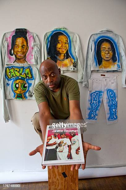 American Hip hop clothing artist Ed Shirt King Phade poses with some of his aerosoled tshirt designs New York 25th June 2013