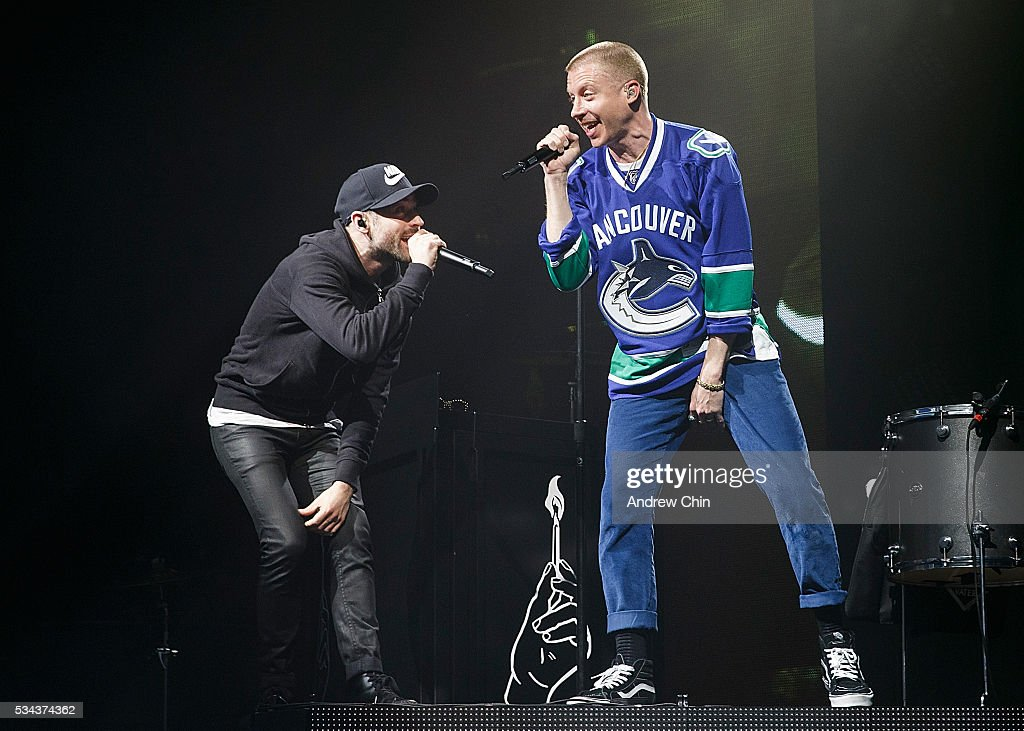 American hip-hop duo Macklemore (R) and Ryan Lewis (L) perform onstage during their North American 'The Unruly Mess I've Made' world tour at PNE Forum on May 25, 2016 in Vancouver, Canada.