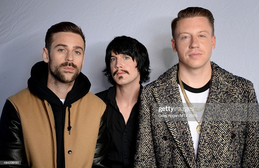 American hiphop duo Macklemore and Ryan Lewis pose with Eric Nally for a portrait before the MTV EMA's at the Mediolanum Forum on October 25 2015 in...