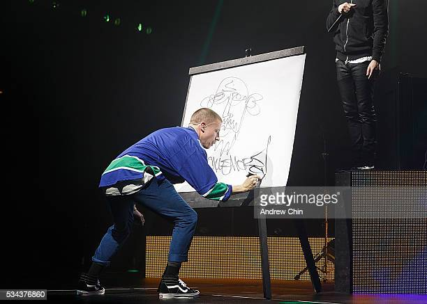 American hiphop duo Macklemore of Macklemore and Ryan Lewis performs onstage during their North American 'The Unruly Mess I've Made' world tour at...