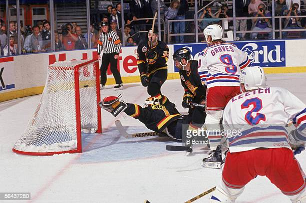 American hockey player Brian Leetch of New York Rangers scores the first goal in during game 7 of the Stanley Cup finals against the Vancouver...
