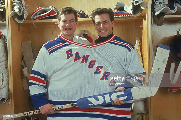 American hockey players Mike Richter and John Vanbiesbrouck both goalies for the New York Rangers pose together in one large jersey January 1991