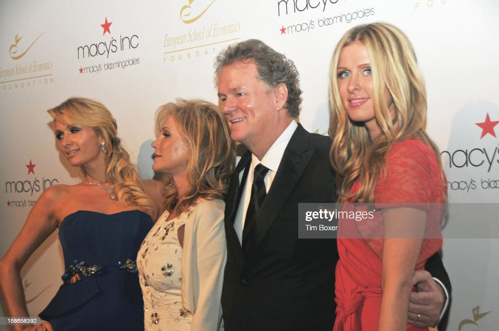 American hotelier Richard Hilton poses with his wife, Kathy (second left), and socialite daughters, Paris (left) and Nicky as they attend a dinner for the European School of Economics Foundation at Cipriani, New York, New York, December 5, 2012.