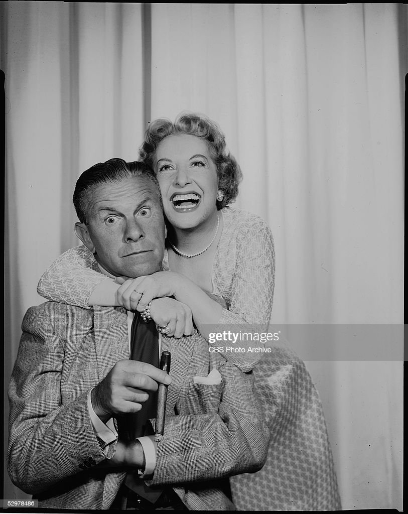 American husband and wife comedy team George Burns and Gracie Allen are seen as he sits and she hugs him in a publicity photo for their CBS sitcom...