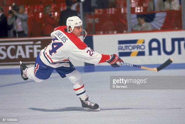 American ice hockey player Chris Chelios of the Montreal Canadiens fires the puck up the ice during the 1989 Stanley Cup Finals