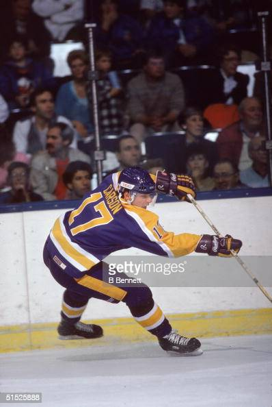 American ice hockey player Jimmy Carson #17 for the Los Angeles Kings shots the puck during an away game against the New York Islanders at Nassau...