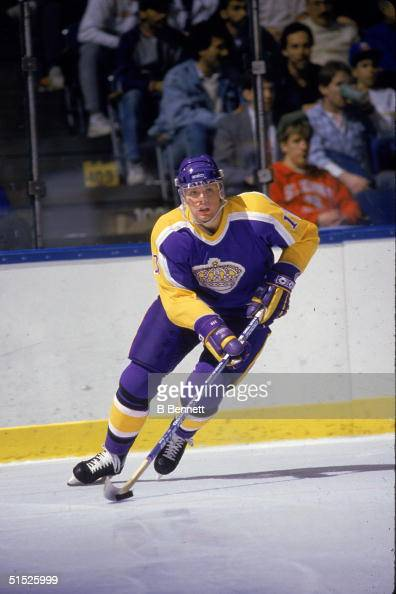 American ice hockey player Jimmy Carson #17 for the Los Angeles Kings skates up the ice with the puck in an away game against the New York Islanders...