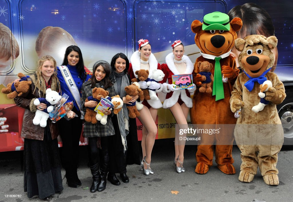 American Idol contestant Crystal Bowersox, Miss USA Rima Fakih, actress Teala Dunn, TV personality from 'Real Housewives of New Jersey' Danielle Staub, The Radio City Rockettes, Yogi Bear, and Boo Boo attend CitySights NY's 2010 Holiday Joy Toy Drive at The Children's Aid Society on December 13, 2010 in New York City.
