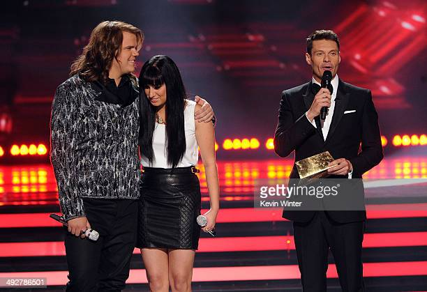 American Idol Finalists Caleb Johnson and Jena Irene wait for the results from host Ryan Seacrest onstage during Fox's 'American Idol' XIII Finale at...