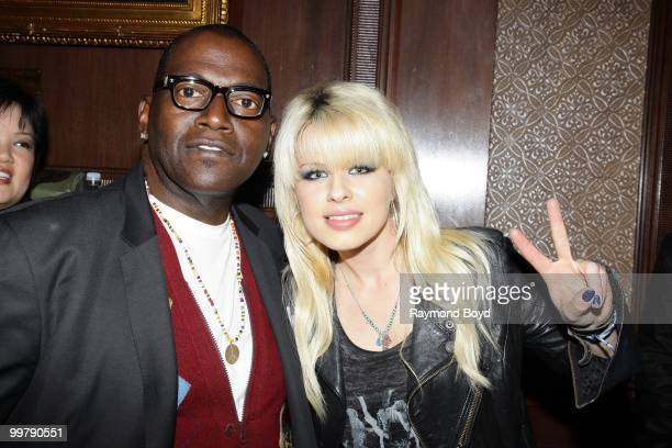 'American Idol' judge and music producer Randy Jackson and singer Orianthi poses for photos in the 'Universal Music Suite' at the Hilton Chicago...