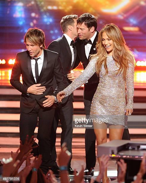 American Idol Judge Keith Urban host Ryan Seacrest judges Harry Connick Jr and Jennifer Lopez speak onstage during Fox's 'American Idol' XIII Finale...