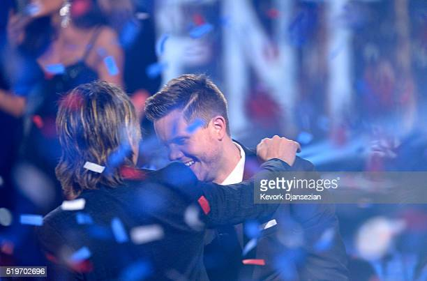 American Idol Season 15 winner Trent Harmon celebrates with recording artist Keith Urban onstage during FOX's 'American Idol' Finale For The Farewell...