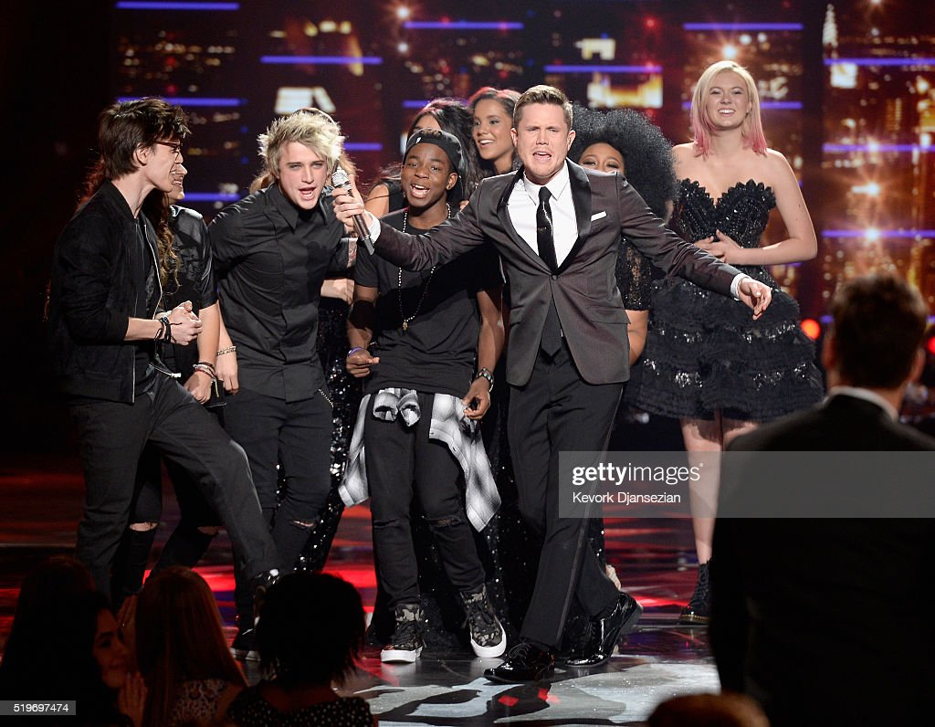 American Idol Season 15 winner Trent Harmon (C) performs coronation song with cast of Season 15 onstage during FOX's 'American Idol' Finale For The Farewell Season at Dolby Theatre on April 7, 2016 in Hollywood, California. at Dolby Theatre on April 7, 2016 in Hollywood, California.
