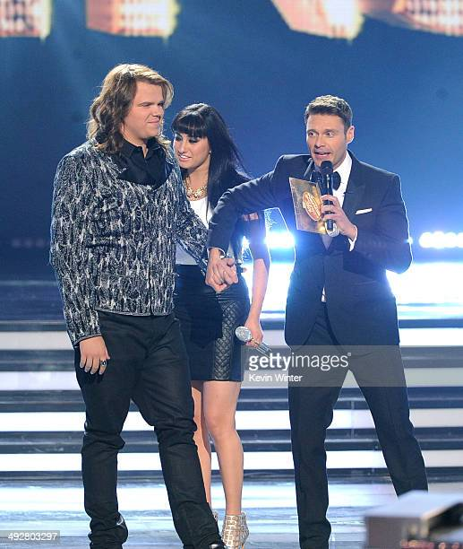 American Idol Winner Caleb Johnson and runner up Jena Irene react onstage with host Ryan Seacrest during Fox's 'American Idol' XIII Finale at Nokia...