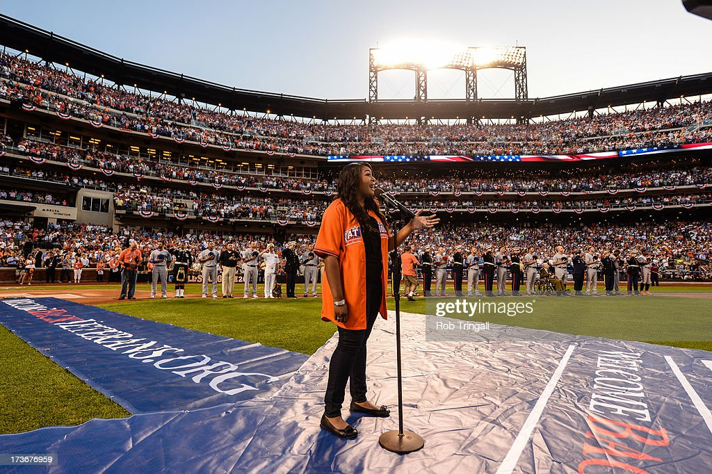 American Idol winner Candice Glover sings the National Anthem during the 84th MLB All-Star Game at Citi Field on Tuesday, July 16, 2013 at Citi Field in the Flushing neighborhood of the Queens borough of New York City.