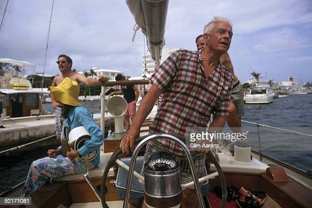 American industrialist Thomas J Watson Jnr brings in his boat the Palawan at the finish of a Newport to Bermuda race circa 1970