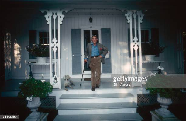 American interior decorator Albert Hadley cofounder of ParishHadley Inc on the porch of his weekend home in Southport Connecticut October 1991