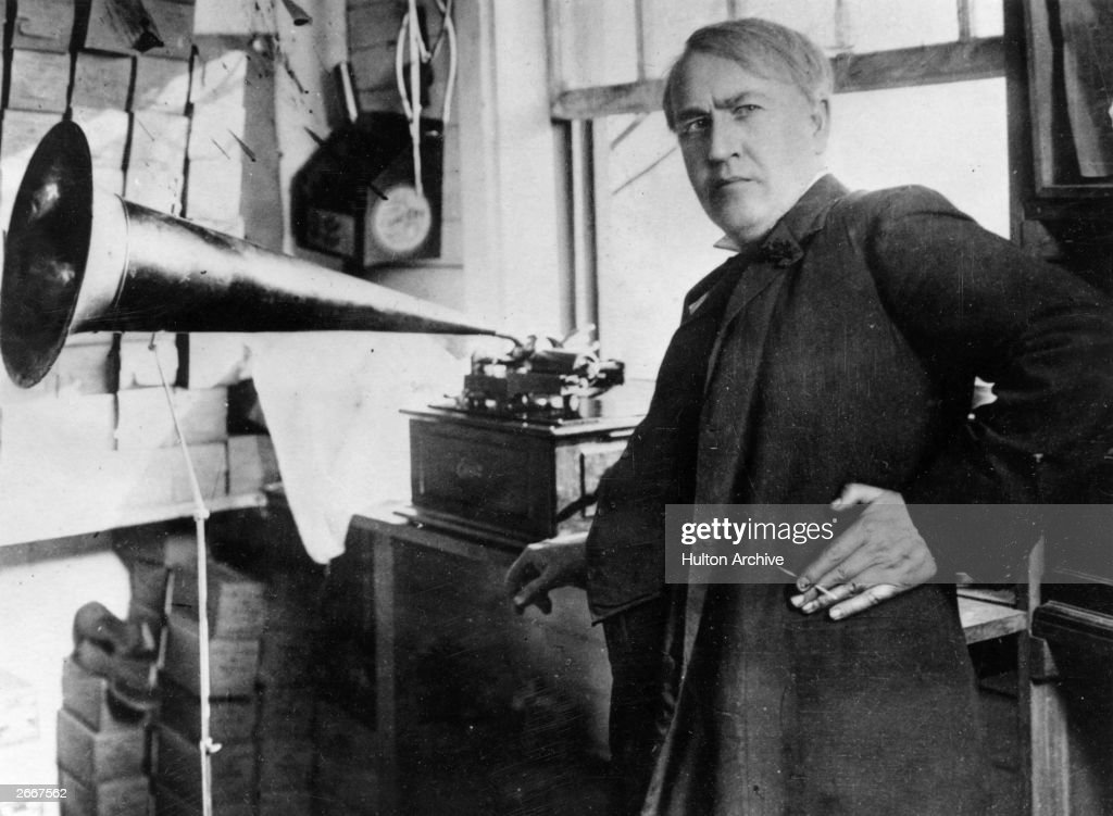 Thomas Alva Edison (1847 - 1931) with the his invention, the phonograph.