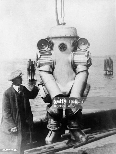 American Inventor H L Bowdoin and his invention a scuba diver with car headlights on each arm on August 17 1931