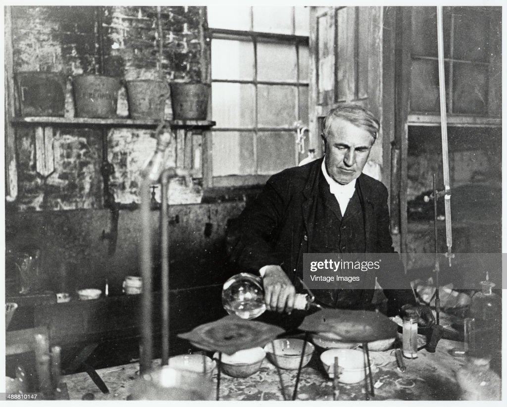 American inventor Thomas Alva Edison (1847 - 1931) in a laboratory, circa 1900.