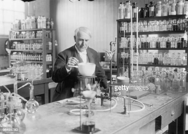 American inventor Thomas Edison conducting an experiment in his laboratory circa 1910