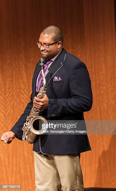 American Jazz composer and musician Jimmy Greene holds his tenor saxophone during an 'MSM Student Project in Performance 'The Compositions of Jackie...