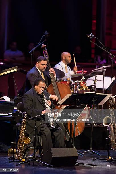 American Jazz composer and musician Wayne Shorter on soprano saxophone performs with Carlos Henriquez on upright acoustic bass Ali Jackson on drums...