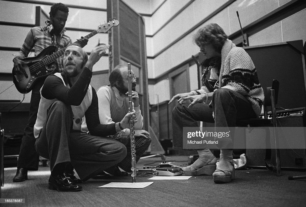 American jazz flautist <a gi-track='captionPersonalityLinkClicked' href=/galleries/search?phrase=Herbie+Mann&family=editorial&specificpeople=893873 ng-click='$event.stopPropagation()'>Herbie Mann</a> (1930 - 2003, second from left) with bassist Calvin 'Fuzzy' Samuels (left) and guitarist <a gi-track='captionPersonalityLinkClicked' href=/galleries/search?phrase=Mick+Taylor&family=editorial&specificpeople=1371171 ng-click='$event.stopPropagation()'>Mick Taylor</a> (right) at Advision Studios, London, during the recording of his album 'London Underground', 6th November 1973.