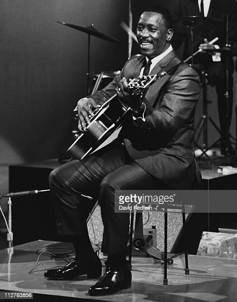 Wes Montgomery US jazz guitarist playing the guitar during a live concert performance circa 1965