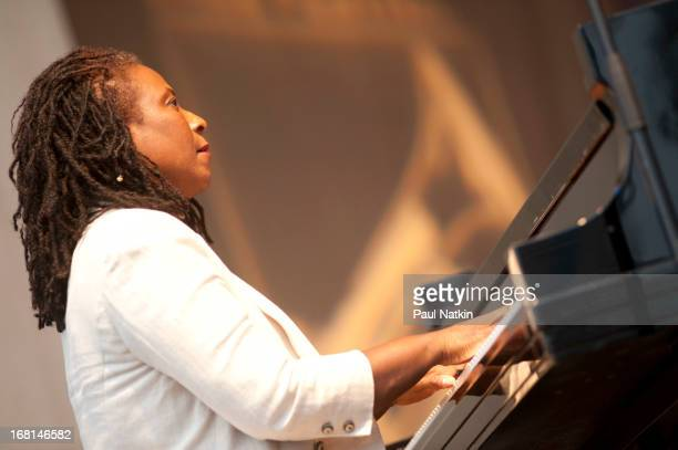 American jazz musician and composer Geri Allen plays piano on stage at the Pritzker Pavilion during the Chicago Jazz Festival Chicago Illinois...