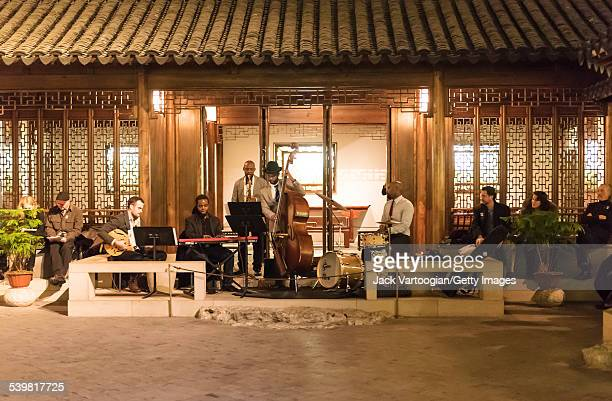 American Jazz musician Ben Williams plays upright acoustic bass as he leads his band Sound Effect as they perform at 'Jazz and Colors at the Met the...