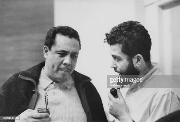 American jazz musician Charles Mingus smokes a pipe with journalist and music critic Nat Hentoff late 1950s or early 1960s